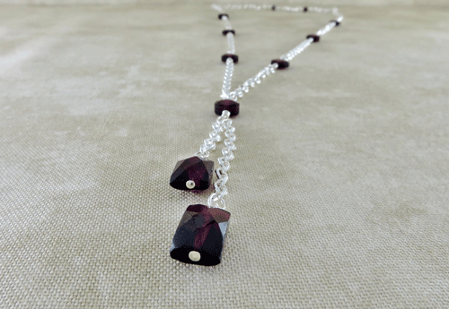 garnet necklace, January birthstone necklace, lariat necklace, y necklace, silver necklace, sterling necklace, gemstone necklace, gemstone jewelry, layering necklace, garnet jewelry, red necklace, Silver Echoes, minimalist necklace, minimalist jewelry, modern necklace, modern jewelry, simple necklace, simple jewelry, everyday necklace, everyday jewelry, dainty necklace, dainty jewelry, elegant necklace, Zen necklace, Zen jewelry, energy necklace, energy jewelry, Reiki necklace, Reiki jewelry, healing necklace, healing jewelry, chakra jewelry, chakra necklace, power jewelry, power necklace, handmade necklace, handmade jewelry, handcrafted necklace, handcrafted jewelry, artisan necklace, anniversary gift, Valentines gift, birthday gift, anniversary gift, Christmas gift, gifts for her, Mother's day gift, wedding gift, wedding necklace, wedding jewelry, bridesmaid necklace, bridesmaid jewelry, bridal necklace, bridal jewelry, flower girl necklace, flower girl jewelry, mother of the bride necklace, mother of the bride jewelry