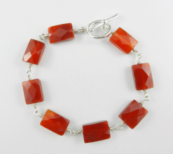 carnelian bracelet, carnelian jewelry, orange jewelry, orange bracelet, carnelian and silver bracelet, silver and carnelian bracelet, silver bracelet, sterling bracelet, sterling silver bracelet, silver toggle bracelet, crystal bracelet, Silver Echoes, wire wrapped bracelet, wire wrapped sterling silver bracelet, wire wrapped sterling bracelet, gemstone bracelet, gemstone jewelry, Reiki bracelet, Reiki jewelry, chakra bracelet, chakra jewelry, crystal jewelry, energy bracelet, energy jewelry, power bracelet, power jewelry, healing bracelet, healing jewelry, artisan bracelet, handmade bracelet, handcrafted bracelet, birthday gift, Valentines gift, Mother's Day gift, Christmas gift, gift for her, artisan jewelry