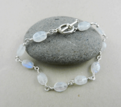 rainbow moonstone, rainbow moonstone bracelet, rainbow moonstone and silver bracelet, silver bracelet, sterling silver bracelet, rainbow moonstone and silver bracelet, rainbow moonstone and sterling silver bracelet, artisan bracelet, artisan silver bracelet, artisan sterling silver bracelet, toggle clasp, sterling silver toggle clasp, silver toggle clasp, sterling silver jewelry, silver jewelry, wire wrapped silver, wire wrapped sterling silver, oval beads