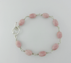 rhodochrosite, rhodochrosite bracelet, silver bracelet, sterling silver bracelet, sterling silver jewelry, silver jewelry, artisan bracelet, toggle clasp, sterling silver toggle clasp, rhodochrosite beads, oval beads, pink bracelet, wire wrapped silver, wire wrapped sterling silver