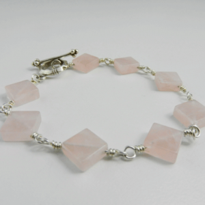 rose quartz, rose quartz bracelet, silver bracelet, sterling silver bracelet, rose quartz and silver bracelet, rose quartz and sterling silver bracelet, artisan bracelet, artisan silver bracelet, artisan sterling silver bracelet, handmade bracelet, handcrafted bracelet, handmade rose quartz bracelet, handcrafted rose quartz bracelet, toggle clasp, sterling silver toggle clasp, silver toggle clasp, sterling silver jewelry, silver jewelry, wire wrapped, wire wrapped silver, wire wrapped sterling silver, flat beads, square beads, flat squares, pink beads