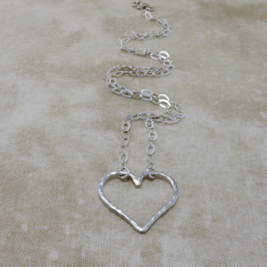 heart shaped necklace, heart necklace, silver necklace, sterling silver necklace, sterling necklace, slender necklace, silver chain necklace, layering necklace, layering jewelry, everyday necklace, hammered silver necklace, Silver Echoes, sweetheart necklace, minimalist necklace, minimalist jewelry, modern necklace, modern jewelry, simple necklace, everyday necklace, everyday jewelry, spiritual necklace, spiritual jewelry, elegant necklace, Zen necklace, Zen jewelry, energy necklace, energy jewelry, Reiki necklace, Reiki jewelry, healing necklace, healing jewelry, chakra jewelry, chakra necklace, power jewelry, power necklace, handmade necklace, handmade jewelry, handcrafted necklace, handcrafted jewelry, artisan necklace, artisan jewelry, wedding necklace, wedding jewelry, bridesmaid necklace, bridesmaid jewelry, bridal necklace, bridal jewelry, New Year's gift, Valentines gift, birthday gift, Mother's Day gift, anniversary gift, Christmas gift, gifts for her, Kwanza gift, Hanukah gift, mother of the bride necklace, mother of the bride jewelry