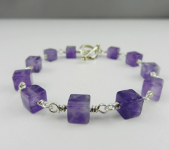 amethyst, square amethysts, amethyst bracelet, amethyst and silver bracelet, silver bracelet, sterling silver bracelet, amethyst and sterling silver bracelet, artisan bracelet, handmade bracelet, handcrafted bracelet, toggle clasp, silver toggle clasp, sterling silver toggle clasp, silver jewelry, wire wrapped silver, wire wrapped sterling silver, square beads, purple beads, birthstone jewelry, birthstone bracelet, February birthstone