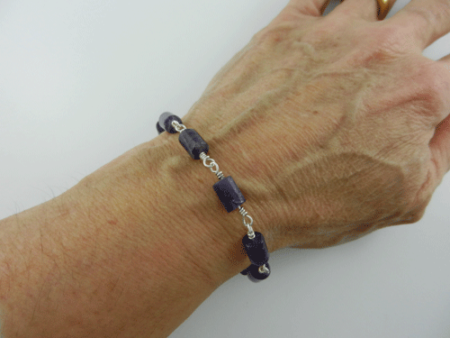 amethyst, tube amethysts, amethyst bracelet, amethyst and silver bracelet, silver bracelet, sterling silver bracelet, amethyst and sterling silver bracelet, artisan bracelet, handmade bracelet, handcrafted bracelet, toggle clasp, silver toggle clasp, sterling silver toggle clasp, silver jewelry, wire wrapped silver, wire wrapped sterling silver, tube beads, purple beads, birthstone jewelry, birthstone bracelet, February birthstone