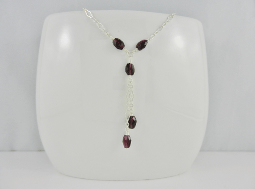 facetted ovals, garnet and silver necklace, garnet and sterling silver necklace, garnet necklace, silver necklace, sterling silver necklace, handmade, handcrafted, artisan, handmade necklace, handcrafted necklace, artisan necklace, January birthstone necklace, birthstone necklace, wire wrapped, wire wrapped sterling silver, wire wrapped silver, sterling silver lobster claw clasp, silver lobster claw clasp, birthstone necklace, January birthstone, birthstone collection, Sharon Joy Designs, lariat necklace, lariat