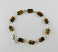 tigers eye, tigers eye bracelet, silver bracelet, sterling silver bracelet, sterling silver jewelry, silver jewelry, artisan bracelet, toggle clasp, sterling silver toggle clasp, tiger's eye beads, tube beads, brown bracelet, wire wrapped silver, wire wrapped sterling silver