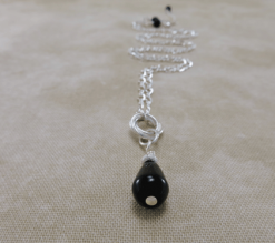 onyx necklace, silver necklace, pendant necklace, sterling necklace, layering necklace, teardrop onyx necklace, teardrop pendant, gemstone necklace, wire wrap necklace, everyday necklace, gemstone jewelry, black necklace, Silver Echoes minimalist necklace, minimalist jewelry, modern necklace, modern jewelry, simple necklace, simple jewelry, everyday jewelry, dainty necklace, dainty jewelry, elegant necklace, elegant jewelry, handmade necklace, handcrafted necklace artisan necklace, artisan jewelry, Zen necklace, Zen jewelry, healing necklace, healing jewelry, power necklace, power jewelry, Reiki necklace, Reiki jewelry, chakra necklace, chakra jewelry, bridesmaid gift, bridesmaid necklace, wedding necklace engagement gift, wedding jewelry, bridal necklace, New Years gift, Christmas gift, Valentines gift, birthday gift, mother's day gift, mothers day gift, Kwanza gift, Hanukah gift, anniversary gift, gifts for her, gifts for women, wedding gift