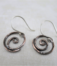rustic spiral earrings, copper earrings, mixed metal earrings, argentium ear wires, small drop earrings, dangle earrings, tribal earrings, primitive earrings, rustic earrings, everyday earrings, lightweight earrings, minimalist earrings, modern earrings, hammered copper earrings, artisan earrings, handcrafted earrings, handmade earrings, summer earrings, simple earrings, hypoallergenic earrings, geometric earrings, Silver Echoes bridal jewelry, bridal earrings, wedding jewelry, wedding earrings, bridesmaid gift, bridesmaid earrings, bridesmaid jewelry, wedding gift, anniversary gift, birthday gift, Christmas gift, Valentine's gift, Mother's Day gift, Hanukah gift, Kwanza gift, gifts for her